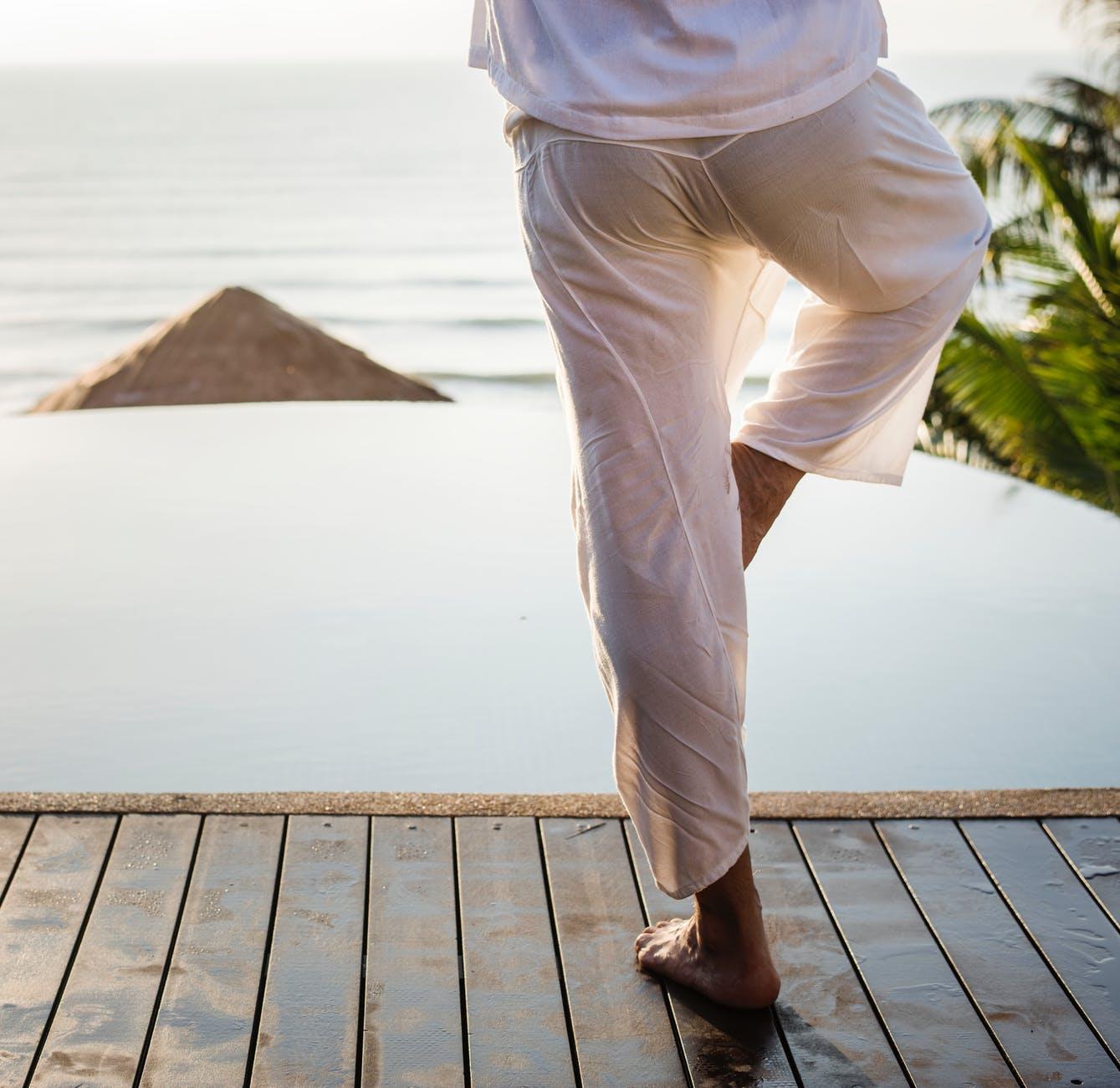 person standing on boardwalk